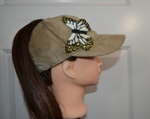Beige Suede baseball cap with a sequined butterfly has a high opening for a ponytail without the need for barrettes or holder