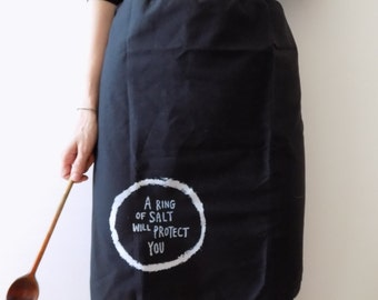 A RING OF SALT will protect you Black witchy Apron