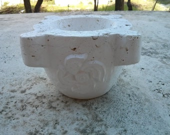 Travertine mortar with different representations (pink, Apple, flower) hand carved