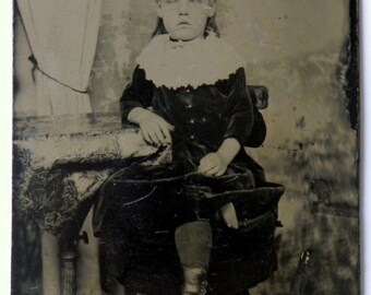 Antique 1800's tintype photograph of young girl dressed in her Sunday best
