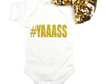 Two Piece Set Baby girl onesie, white, with #YAAASS. Gold sequin hair bow included.