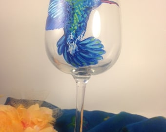 A Highly detailed, Hand Painted 7.5 by 3.5 inches Blue Hummingbird Wineglass