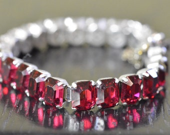 Vintage red rhinestone bracelet with spring clasp and safety chain