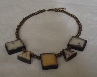 raku, naked raku collar and bronze beads