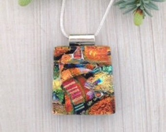 Multicoloured layered dichroic glass pendant with layers of depth