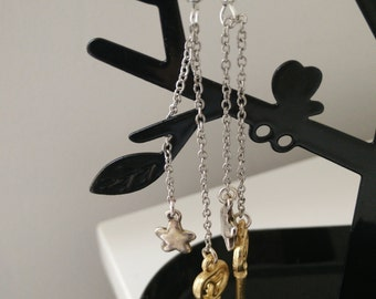 Dangling earrings star and key