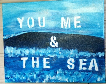 """Acrylic painted canvas of ocean waves and """"You Me And The Sea written on it, We do custom canvases, Canvas signs, Acrylic paintings"""