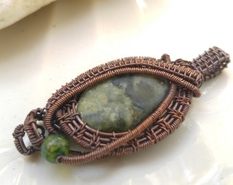 Handmade pendant with green cloud jasper in oxidized antiqued copper wire. Vintage jewelry