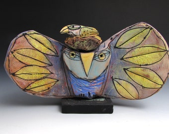 "Owl, handmade one of a kind art,""Owl Person and Nesting Bird Holding Space for the Dream of Love."" 7-1/2"" wide"