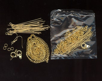 Vintage Factory Sealed Packets 2 Feet Gold Tone Chain, Head Pins, Eye Pins, Jump Rings, Ear Wires, And Spring Rings