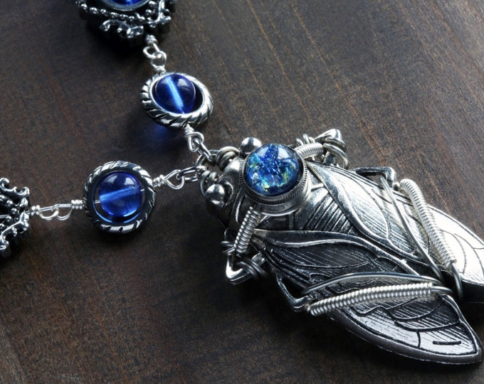 Steampunk Jewelry -  Necklace- Cicada with blue Harlequin glass