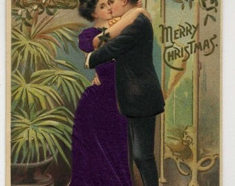 Antique Merry Christmas Postcard - Woman Wears Applied Cloth Clothing - Kissing Under Mistletoe