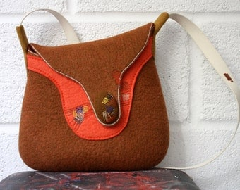 Hand felted wool cross body bag by Onstail for golden autumn season with stitched abstract ornament and strong canvas strap