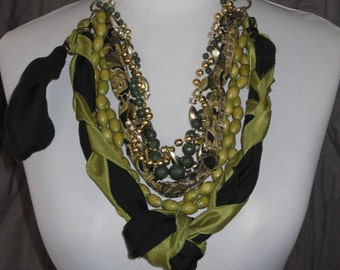 Big Bold Color of Money - green and black textile and bead strand knot statement necklace