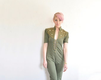 olive green jumpsuit with gold STUDS and gems . very tough very hardcore .small.medium .sale