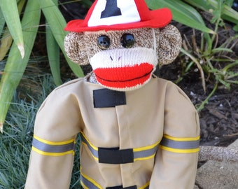 Sock Monkey Fireman Doll Dressed in Jacket and Firefighter Hat. Personalization Option on Back of Jacket