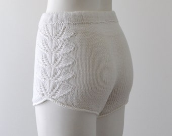 Hand knitted high waisted shorts in white.