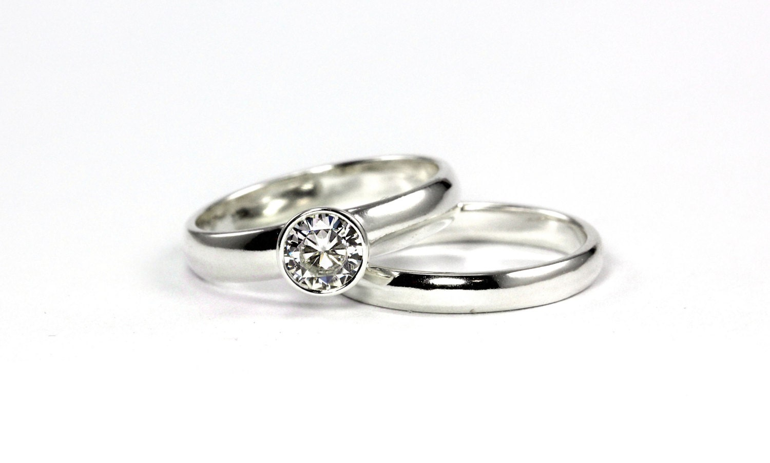 low profile moissanite engagement ring by alyshawhitfield