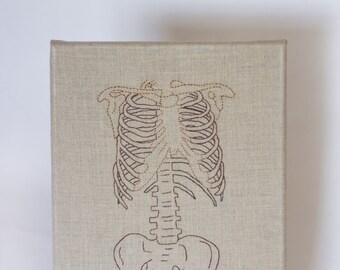 Hand embroidered skeleton