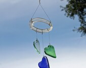 green blue and tinted clear glass hearst valentine's day wind chime mobile from recycled bottles