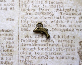 SALE - 15 TINY Dolphin Charms in Bronze Tone - C2332
