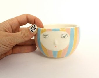 Striped coffee bowl with face - cache pot / container