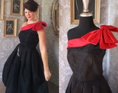 Vintage Black One Shoulder Cocktail Dress with Red Bow Accent M/L