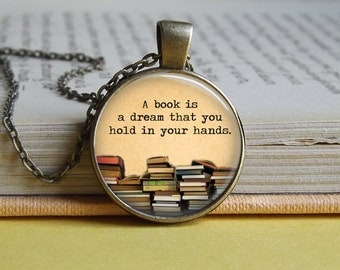 Silver or bronze 'A book is a dream you can hold in your hands' quote glass dome pendant necklace (books, book pile, reading)