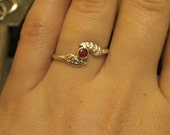 Sterling silver leaf ring with 14k gold setting and ruby