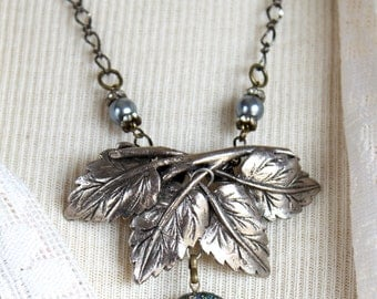 Assemblage Necklace, antique button, vintage leaf dress buckle, antiqued chain