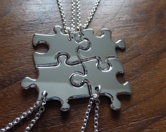 Four Silver Puzzle Pendant Necklaces