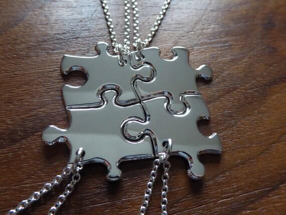 Four Silver Puzzle Pendant Necklaces