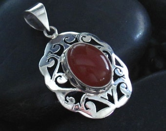 Carnelian Agate Cabochon Pendant in a Scroll Sterling Silver .925 Setting - Nice Larger Stone - Cut Through Scoll Design - Large Bail