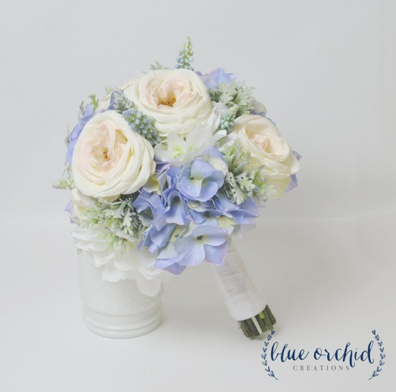 Blue hydrangea bouquet with blush garden roses and dusty