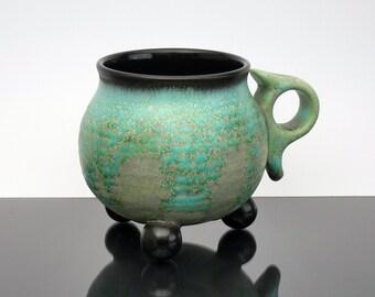 "Unique tripod mug. Wheel thrown coffee mug. Emerald green and black ""ball footed"" mug with ergonomic handle. pottery mug. tea cup"