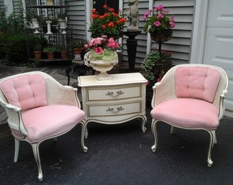 pair of pink cane and velvet chairs