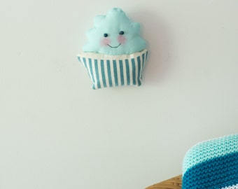 Light teal aqua blue frosting stuffed fabric smiley cupcake wall decor