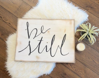Be still black and white rustic wood sign