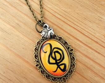 Disney's The Lion King Hakuna Matata Symbol Necklace
