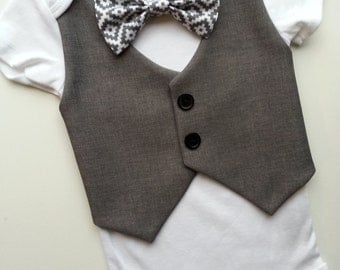 Baby Boy Bodysuit With A Dark Grey Vest Attached And Grey, White Bow Tie.
