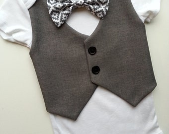 Baby Boy Onesie With A Dark Grey Vest Attached And Grey, White Bow Tie.