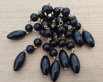 Vintage black bead waterfall brooch
