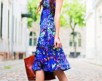 Blue a-line dress. Blue jersey dress with bell shaped skirt. Original digital print of abstract blueberries leaves.