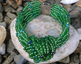 Knotted net beaded bracelet-Green foil lined seed beads.