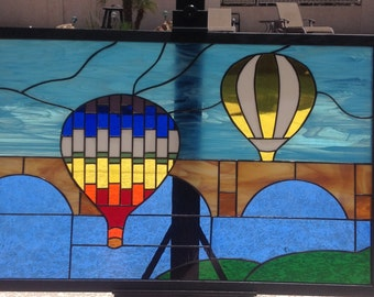 Stained glass balloons over the bridge