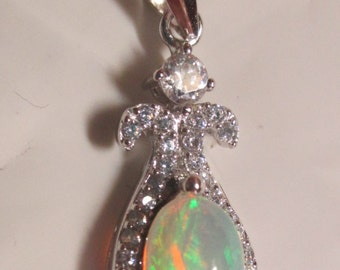 Ladies stunning genuine mined opal pendant in sterling silver with accents