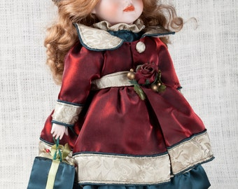 Collectable dolls Beautiful Large Leonardo Porcelain Vintage Doll, Christmas dress holding and gift,patticoat, pantaloons socks,blach shoes.