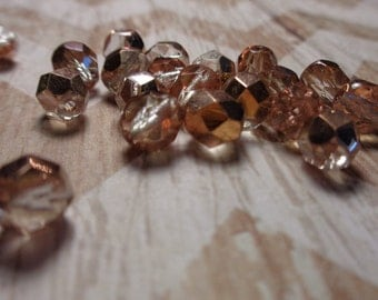 Fire Polished Pink and Gold Sparkly Translucent Glass Round Beads
