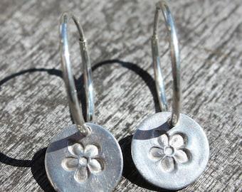 Silver hoop flower earrings handmade in fine silver featuring a silver flower drop hung from sterling silver hoop wires