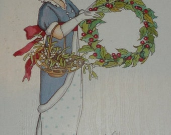on sale Pretty Lady With Basket of Mistletoe and Wreath of Holly Antique Christmas Postcard A/S Margaret Price